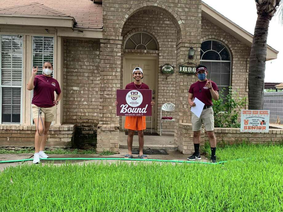 """Texas A&M International University freshman student Jared Nava (center) holds his brand new """"TAMIU Bound"""" lawn sign. A lawn sign and welcome packet were brought to him by New Student Orientation Leaders Yamile Vasquez (left) and Daniel Perez (right). Photo: Courtesy Of TAMIU"""