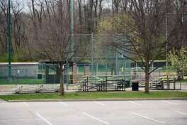 Caution tape wraps around Hoppe Park in Edwardsville in March. On Monday, the Edwardsville Glen Carbon Little League Association made the decision to cancel the season.