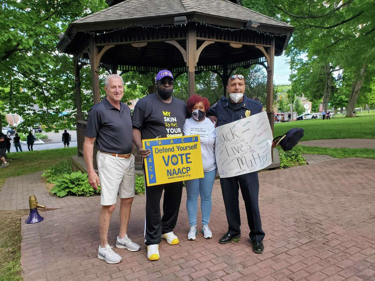 Protest organizer Michel'le Sanders with Mayor Mark Lauretti, NAACP Valley-branch President Greg Johnson and police Chief Shawn Sequeira at the May 31 protest at Huntington Green.
