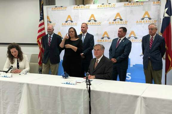 Texas Gov. Greg Abbott, Amarillo Mayor Ginger Nelson and other officials hold a at a news conference Wednesday. The message it sent a reader: Abbott says one thing about controlling the spread of COVID-19 but does something different.