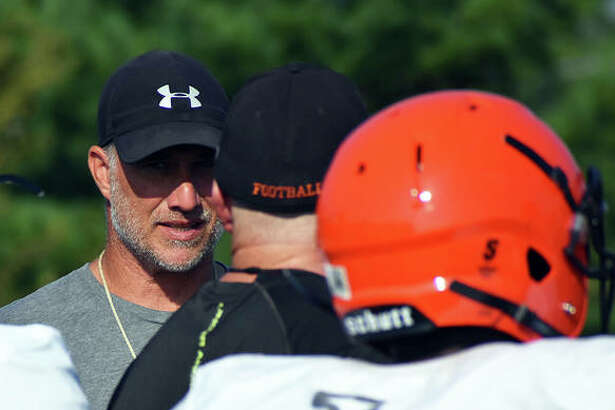 Edwardsville coach Matt Martin watches his football team during a summer practice last year inside the District 7 Sports Complex.