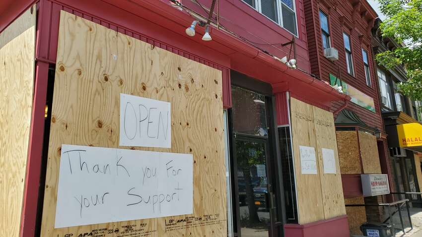 Lo Nuestro Dominican Restaurant was among the businesses damaged by looters over the weekend. (Chris Churchill / Times Union)