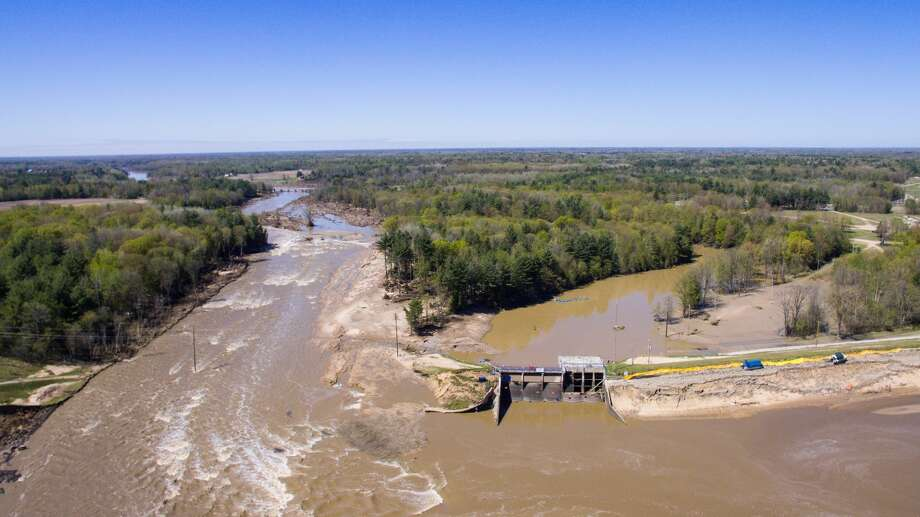 An aerial photo taken May 21, shows the aftermath of record flooding following the breach of the Edenville Dam and failure of the Sanford Dam in Midland County. The Tittabwassee River reached a record 35.05 feet in Midland on May 20. Photo: Adam Ferman/For The Midland Daily News