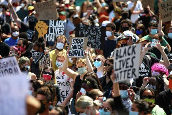 London, England People hold placards in aBlack Lives Matter march at Trafalgar Square on May 31in London. This slideshow was first published on Stacker