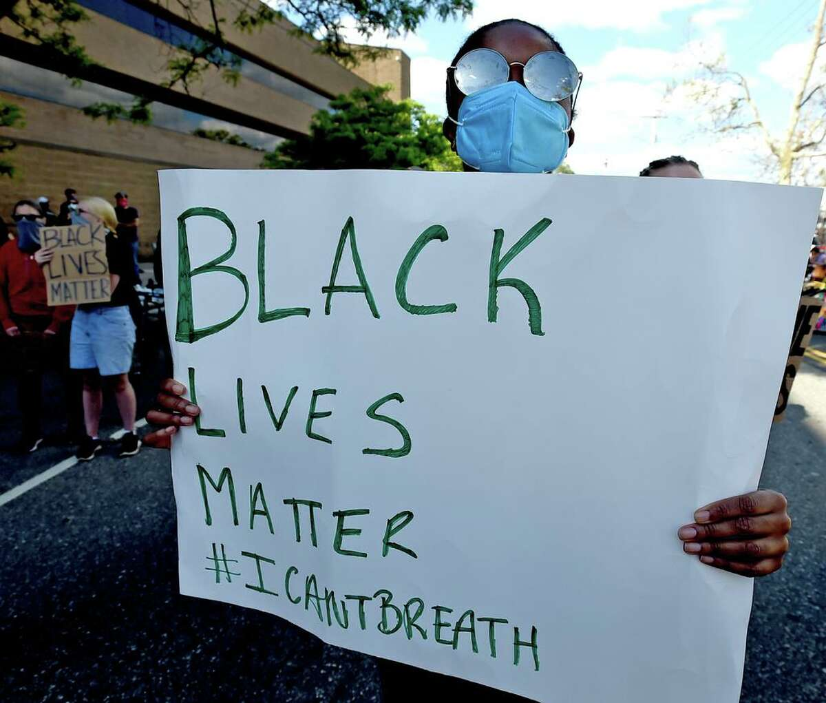 New Haven, Connecticut - Sunday, May 31, 2020: Approximately 1,000 Black Lives Matter protesters and supporters protesting police brutality and the death of George Floyd in Minneapolis S'unday, marched in New Haven Sunday from Broadway to the Green, past Church and blocking the I-95 Highway in New Haven in both directions and then on to New Haven Police Headquarters protesting police brutality and the death of George Floyd in Minneapolis. As of 5:30 P.M. their were no police confrontations.