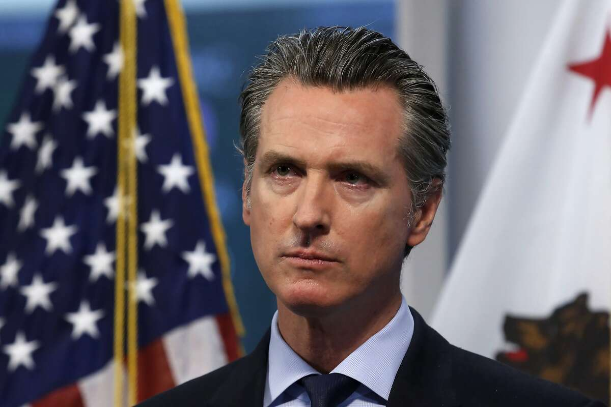 """FILE - In this April 9, 2020, file photo, California Gov. Gavin Newsom listens to a reporter's question during his daily news briefing in Rancho Cordova, Calif. At his briefing Friday, May 29, 2020, Newsom gave a powerful statement on the death of George Floyd at the hands of police in Minneapolis. Newsom recounted how the death of Floyd in police custody in Minnesota impacted his four young children. Newsom said his kids broke down and cried as they struggled to understand how """"bad people are supposed to be bad but good people are supposed to be good.""""(AP Photo/Rich Pedroncelli, Pool, File)"""