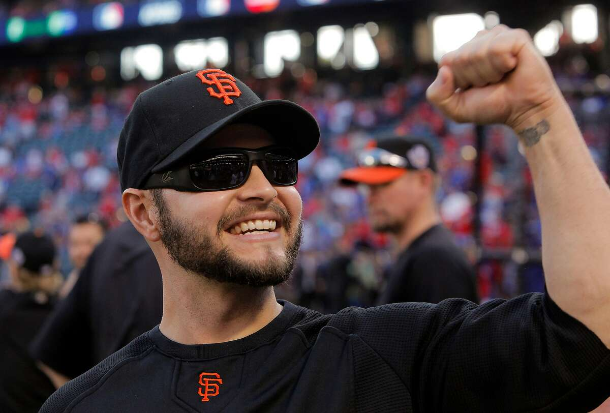 Cody Ross waves to fans in the stands as the Giants warm up before Game 4 of the World Series against the Texas Rangers on Sunday.