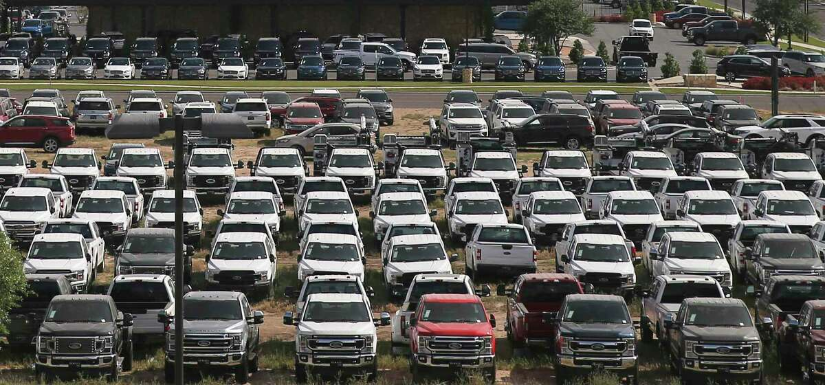 Ford Trucks fill an overflow lot of a dealership in Odessa, Texas on Thursday, April 30, 2020.