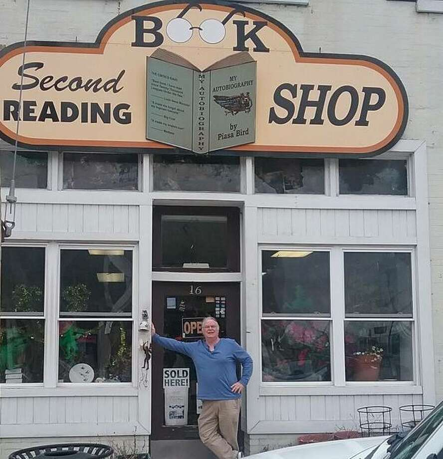 John Dunphy is shown outside the Second Reading Book Shop at 16 E. Broadway that he and Loretta Dunphy own. Once a stop on the Underground Railroad, the business received $1,500 from Alton Main Street to replace rotting wood on the windows and door frame.