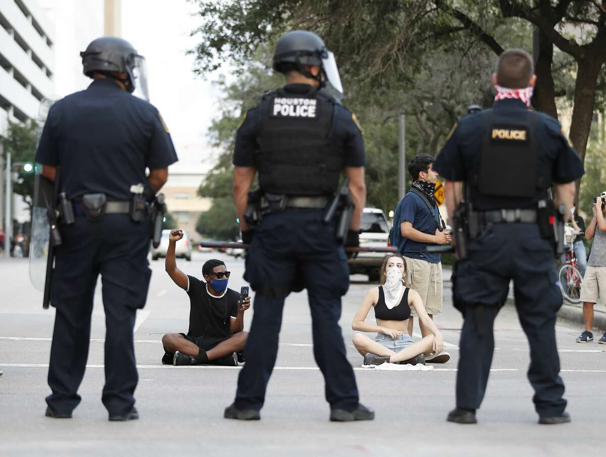 Protesters at Travis and Polk Street at they squared off with Houston Police officers as Black Lives Matter Houston protested the death of George Floyd, in Houston, Friday, May 29, 2020.