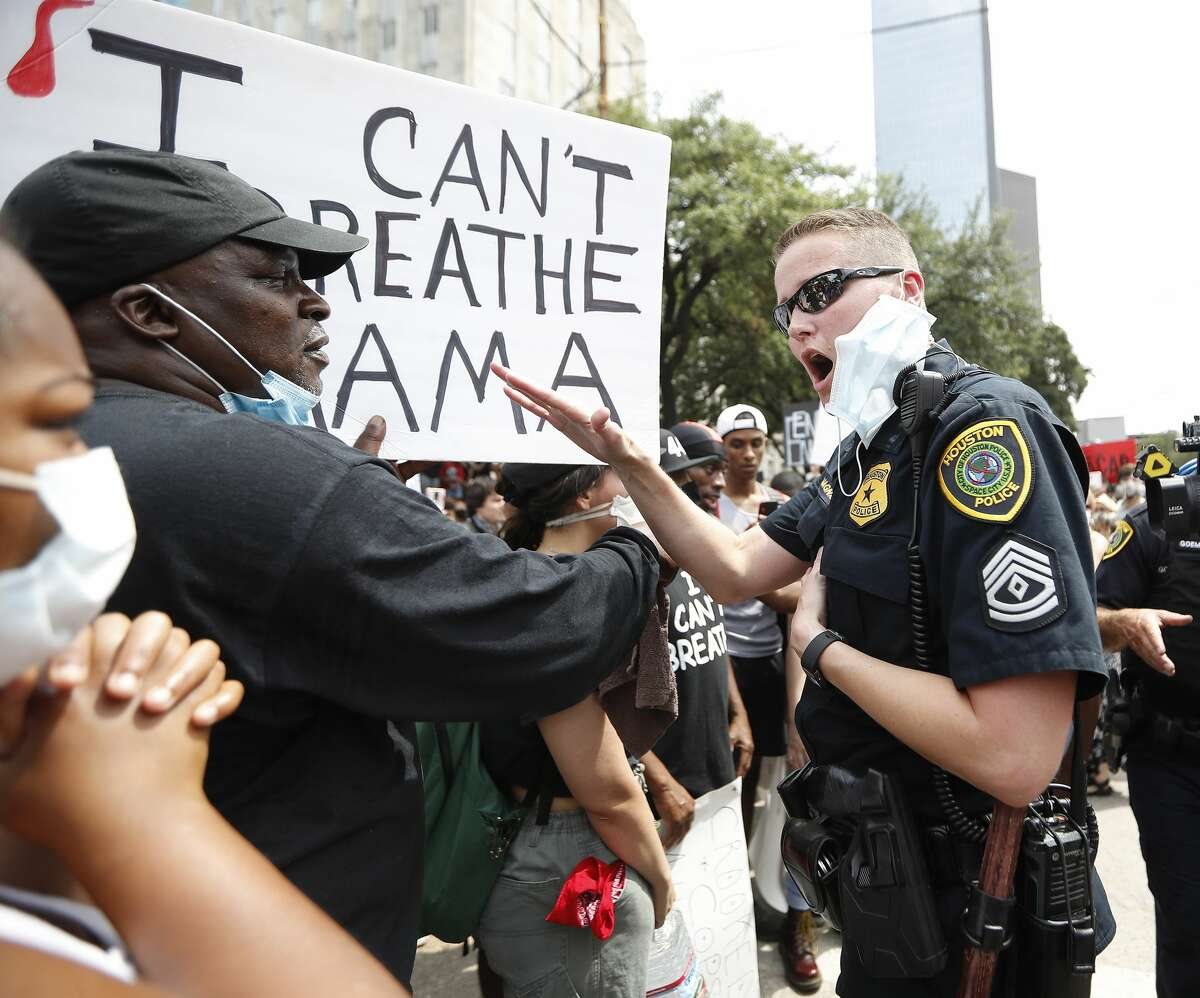 Protesters clash with Houston Police officers, angry about the death of George Floyd, as they took to Bagby Street near City Hall, in Houston, Friday, May 29, 2020.