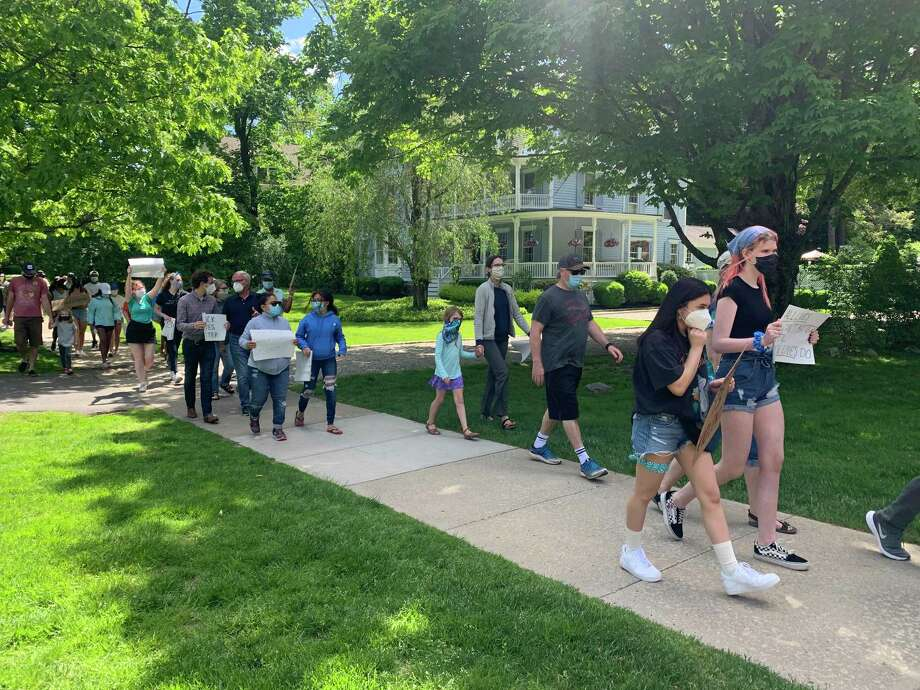 Marchers in Ridgefield on Sunday supported protesters around the nation who have been calling for racial justice. Photo: Rebecca Cosgrove Photo / Contributed