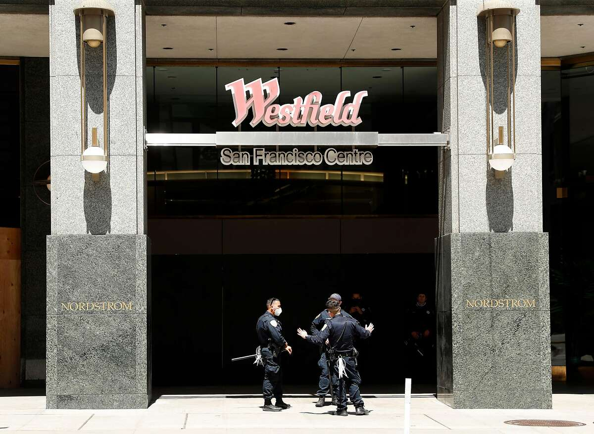San Francisco Police officers stand outside the 5th Street entrance to Westfield Shopping Center in San Francisco, Calif., on Monday, June 1, 2020.