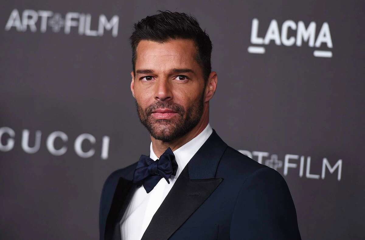 FILE - This Nov. 2, 2019 file photo shows Ricky Martin at the 2019 LACMA Art and Film Gala in Los Angeles. Martin will perform his latest song a€œCA!ntaloa€ with Residente and Bad Bunny at the Latin Grammy Awards on Thursday, Nov., 14, and will also serve as master of ceremonies along actresses Roselyn SA!nchez and Paz Vega. (Photo by Jordan Strauss/Invision/AP, File)