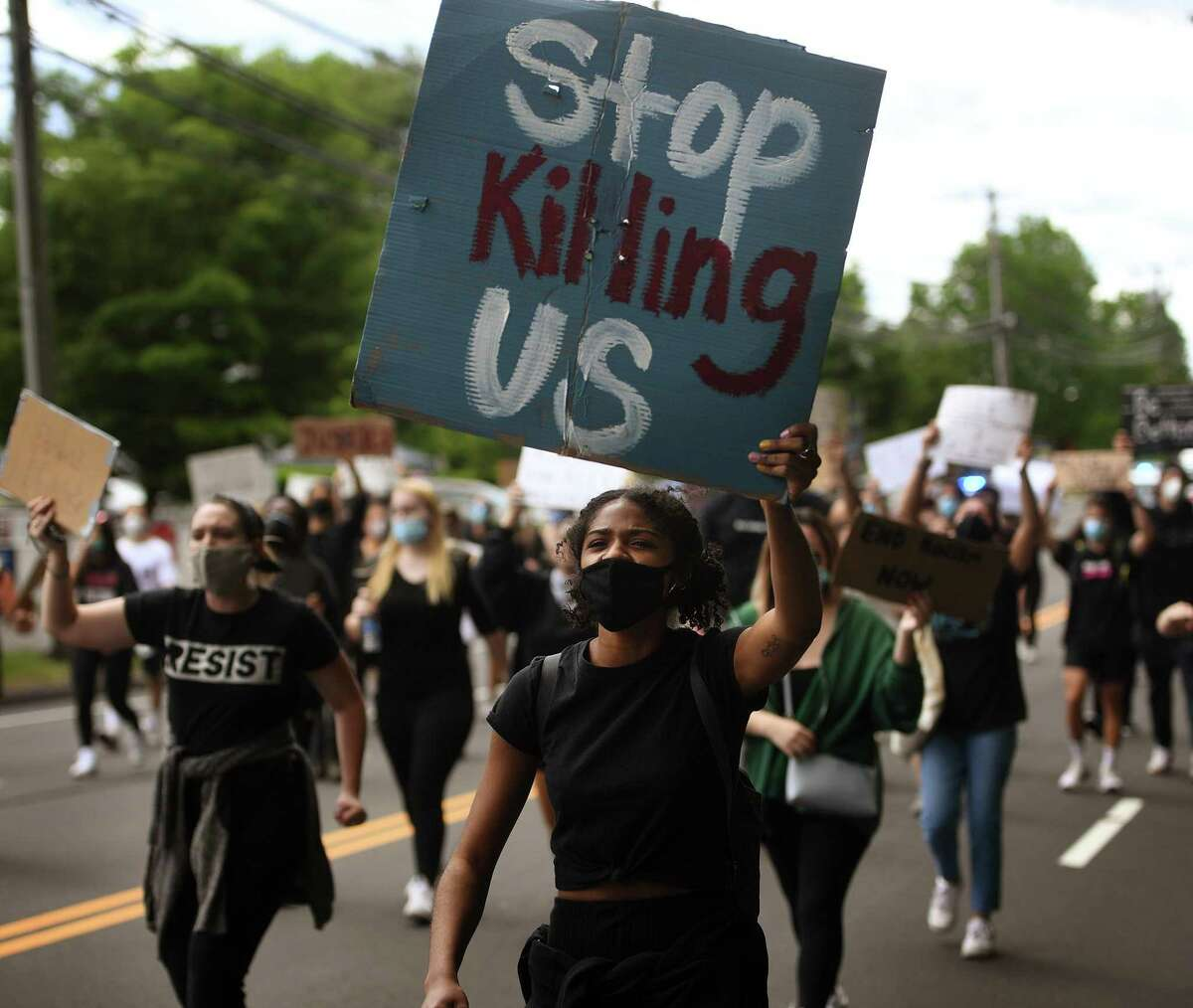 Protestors march up and down the Post Road chanting slogans in a Black Lives Matter protest in Westport on Monday.
