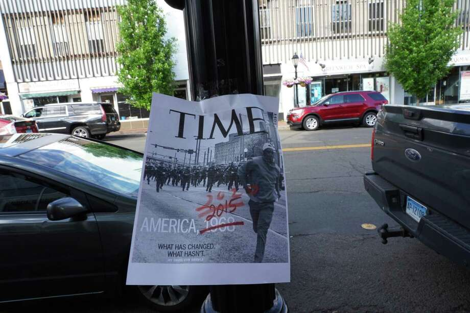 """Someone in New Canaan posted anti-racism signs on Elm Street, and Main Street recently. This letter writer asks, """"When will we have compassion?,"""" along with when will we """"be willing to listen?"""" particularly when it comes to the term racism every day. Photo: Grace Duffield / Hearst Connecticut Media"""