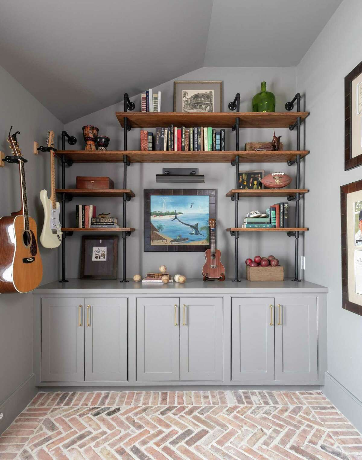 Kiley Jackson and Aileen Warren of Jackson Warren Interiors mixed books with other mementoes to show their client's hobbies and personality.