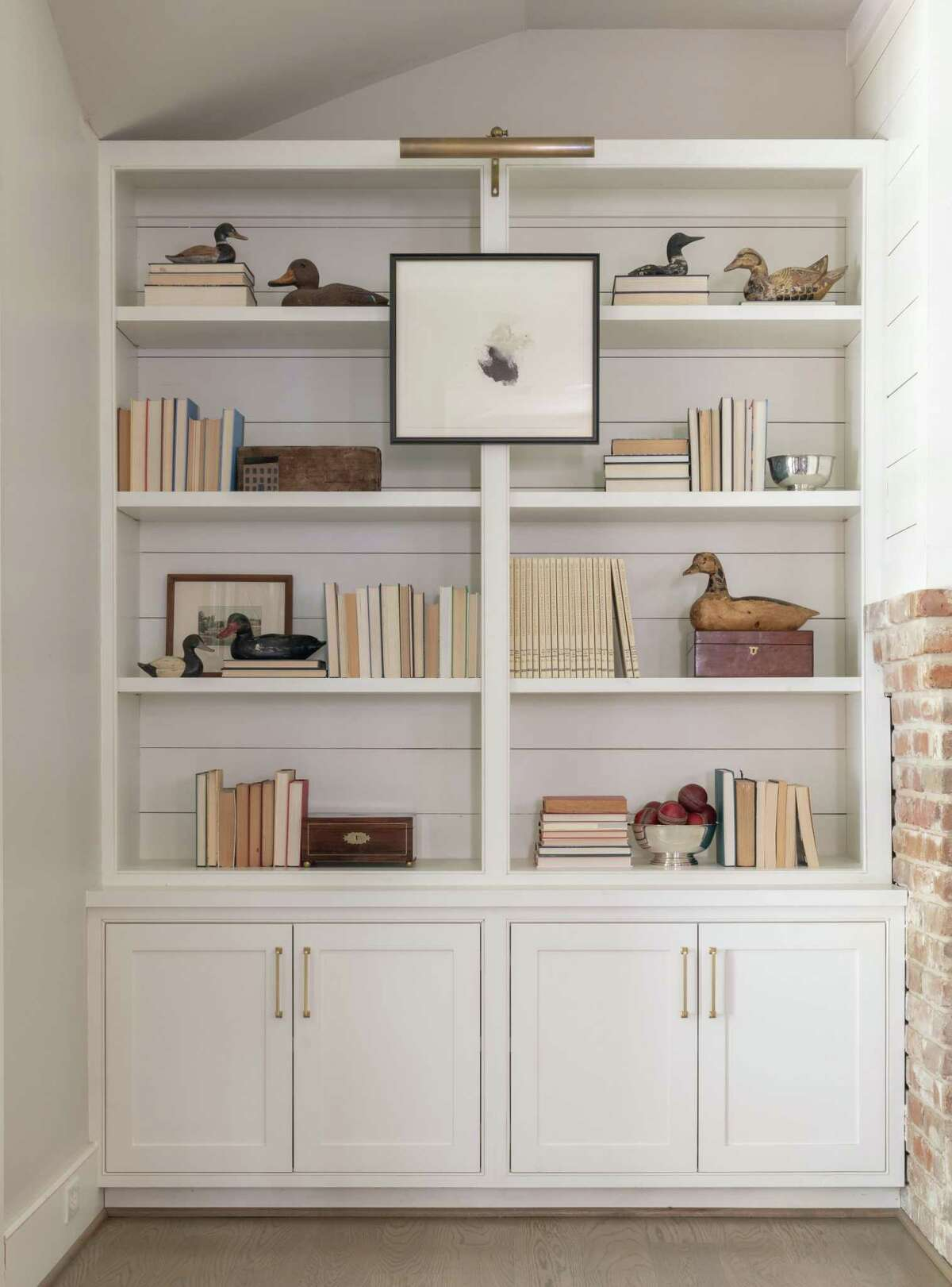 For a monochromatic look, turn books backward so their spines face the wall.
