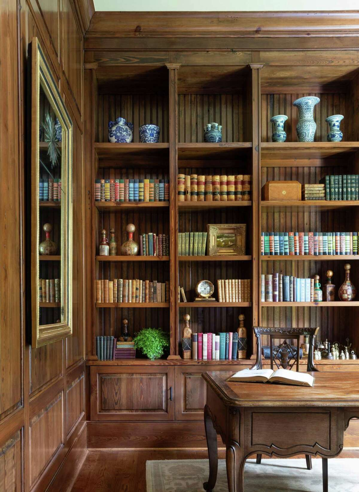 Shelves in this home's library are filled with books, art and collectibles that reflected the homeowner's personality.
