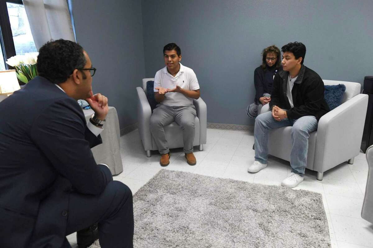 U.S. Rep. Will Hurd, left, listens as high school students Marc Mendiola, left, and Agustin Perez discuss the need for mental health services at at Athens Elementary School on Feb. 20. The pilot program provides mental health resources to all students of the South San ISD.