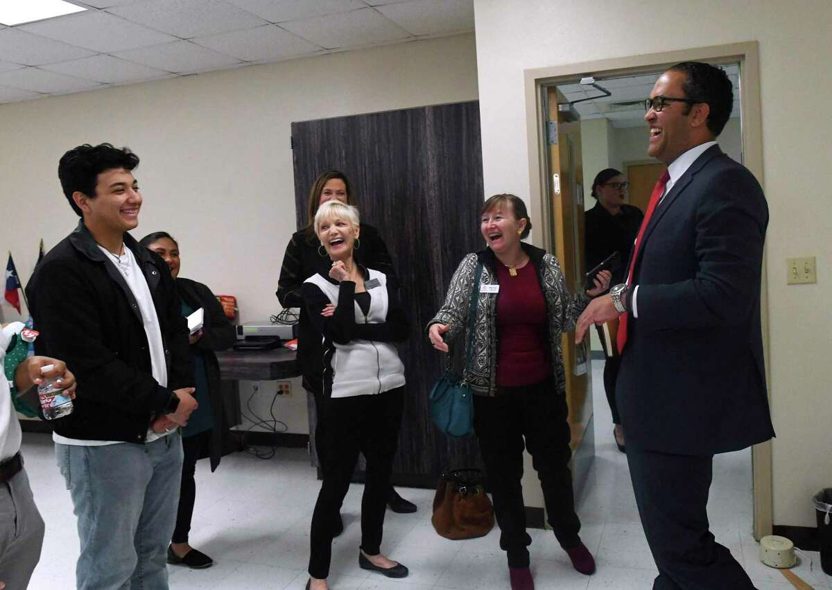 U.S. Rep. Will Hurd jokes with student Agustin Perez earlier this year at the South San ISD Care Zone, a community center where the San Antonio Mobile Mental Wellness Collaborative set up shop.