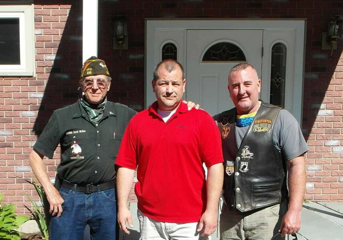 Above, Chaplain David McGee left, Commander Dan Matthews, and brother James Matthews attend a swearing-in ceremony at VFW Post 296 in Winsted. Matthews replaces longtime Commander Neil Hunt, who has served the post for 28 years.