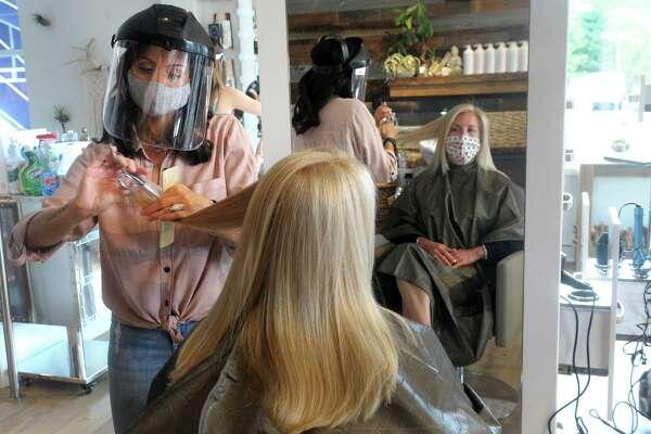 Fairfield First Selectwoman Brenda Kupchick has here hair styled by Gavali Salon owner Gabriella DeStefano in Fairfield, Conn. June 1, 2020.