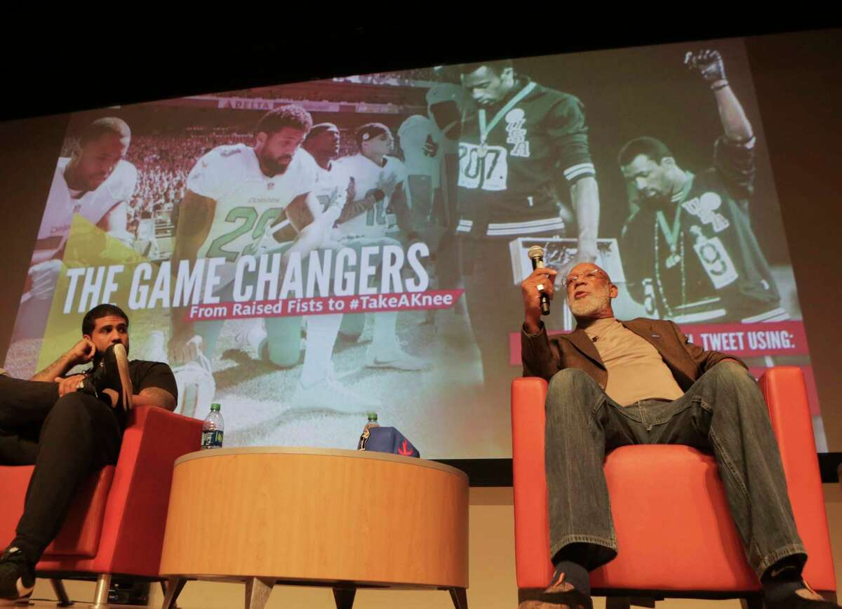 Olympian John Carlos, answers questions with former Texans Arian Foster about athletes and protests during a forum in Houston in 2017.