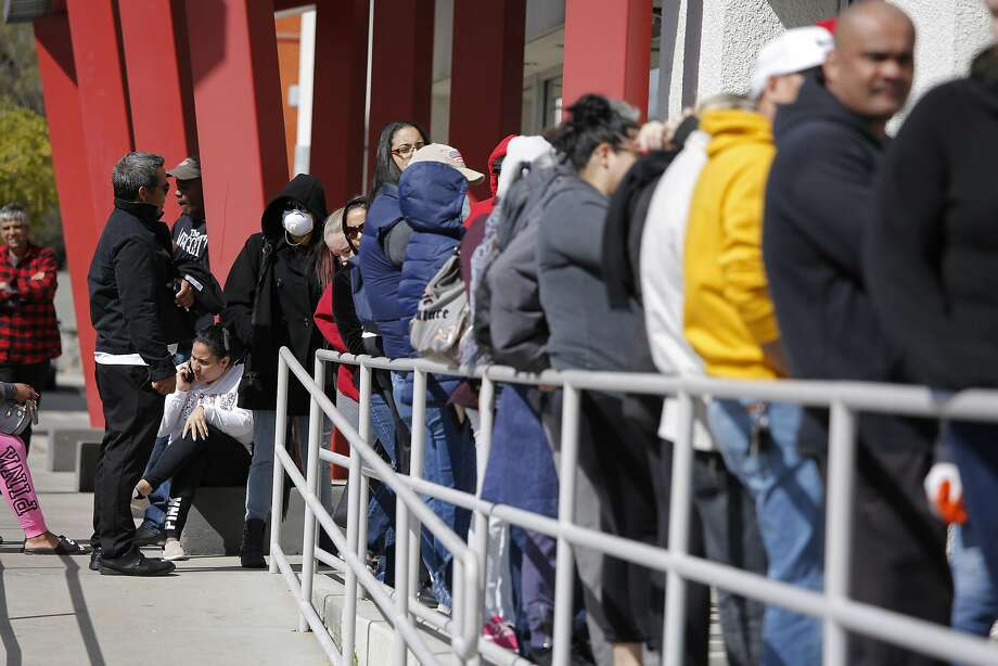 FILE - In this March 17, 2020, file photo, people wait in line for help with unemployment benefits at the One-Stop Career Center in Las Vegas. Nevada jobless figures continue to climb, with more than 18,000 people filing first-time claims for benefits last week. That will add to the record 28.2% statewide unemployment figure in April. The U.S. Labor Department tally on Thursday, May 28 comes after the state last week reported that Nevada unemployment is higher than any state ever, topping even the 25% nationwide estimates made during the Great Depression. (AP Photo/John Locher, File) Photo: John Locher, Associated Press