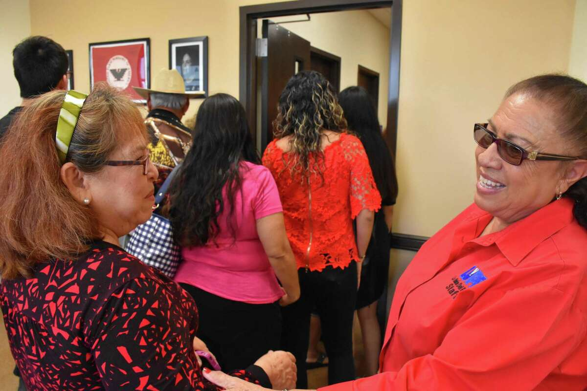 Juanita Valdez-Cox (right), executive director of La Unión del Pueblo Entero, or LUPE, welcomes supporters to the opening of its office in Alton, Texas. LUPE also has offices in San Juan, San Benito and Mercedes.