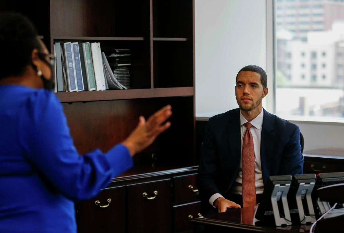Interim Harris County clerk Chris Hollins, right, talks with chief deputy Teneshia Hudspeth, left, before getting on a video call in his new office at the Harris County Civil Courthouse building Wednesday, May 27, 2020, in Houston.