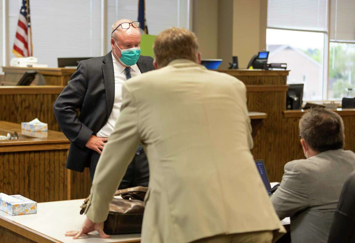 Attorneys speak among themselves while wearing masks during a hearing at the 435th state District Court in Conroe, Monday, June 1, 2020. New safety measures have been put in place to stop any spread of the novel coronavirus.