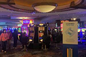 Patrons walk through the main gaming floor at the Foxwoods Resort Casino Monday June 1, 2020, the first day the state's tribal-owned casinos reopened since they closed due to the COVID health threat.