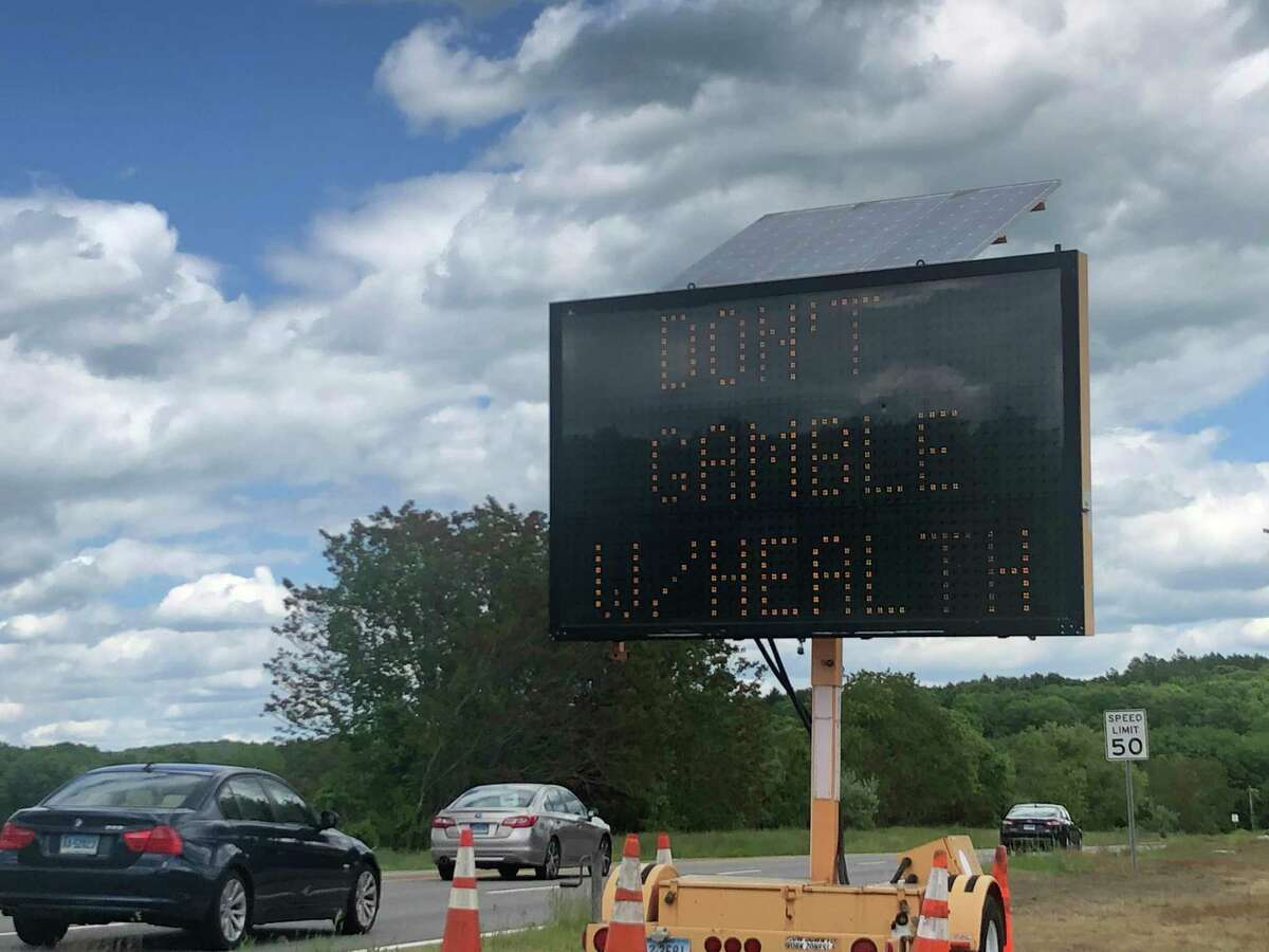 A sign warns drivers headed toward the Foxwoods Resort Casino about health risks on Monday June 1, 2020, the first day Connecticut's tribal casinos reopened.