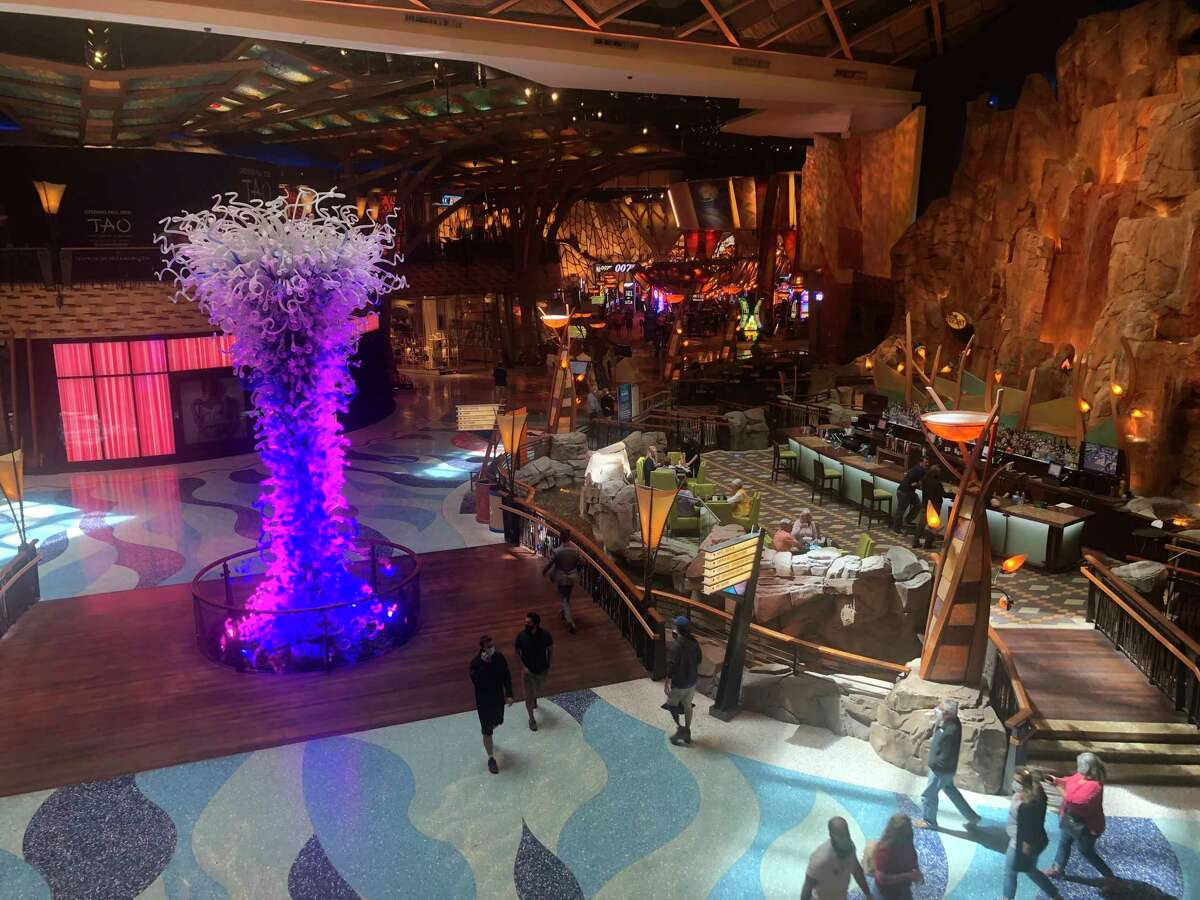 Guests walk through the main hall of the Mohegan Sun Casino on Monday June 1, 2020, the first day the casinos reopened since they closed due to the global coronavirus pandemic.