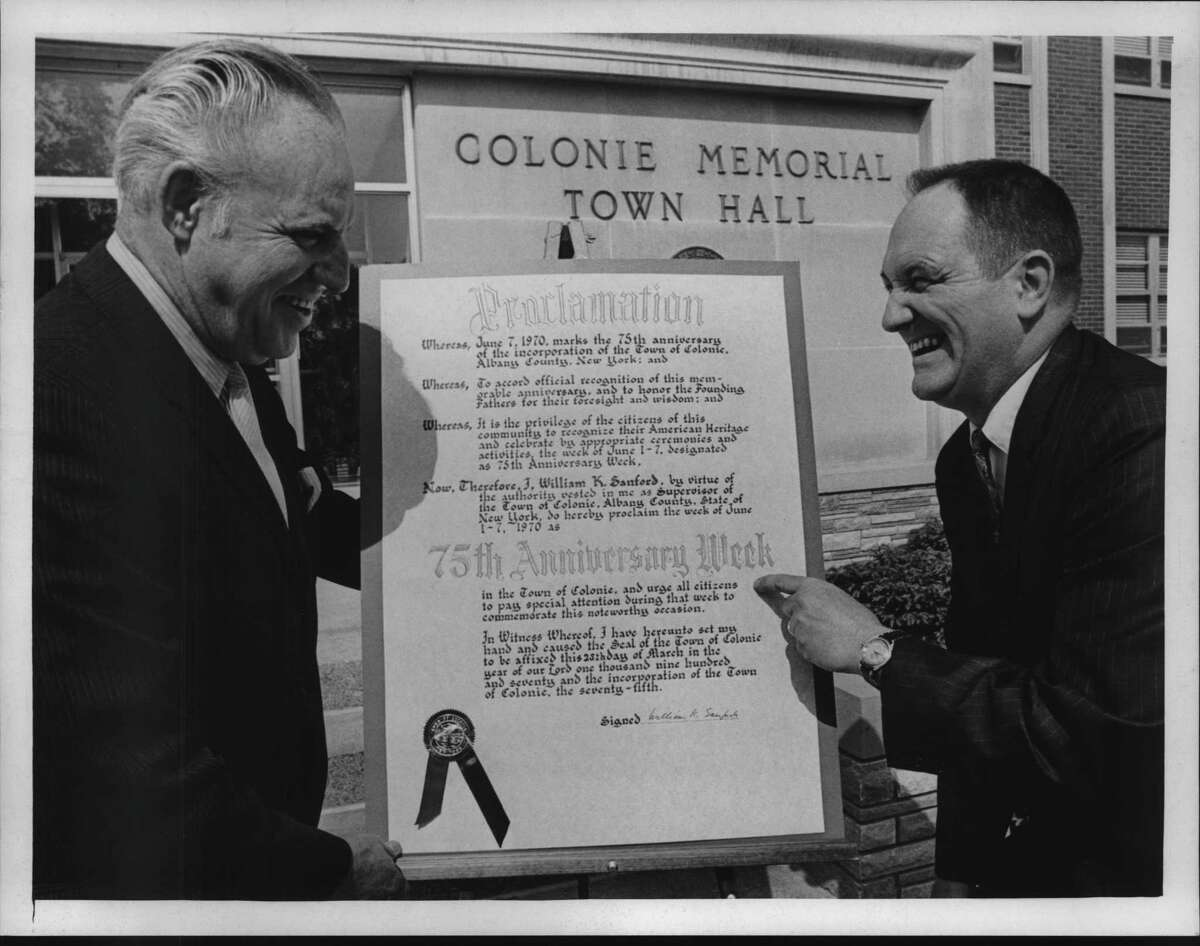 Fifty years ago, officials in Colonie were making plans to celebrate 75th Anniversary Week in the town in early June 1970. Samuel G. Goldey, town councilman, with Joseph C. McAuliffe, general chairman of Diamond Jubilee Celebration, looking over proclamation signed by William Sanford. (Joe Higgins/Times Union Archive)
