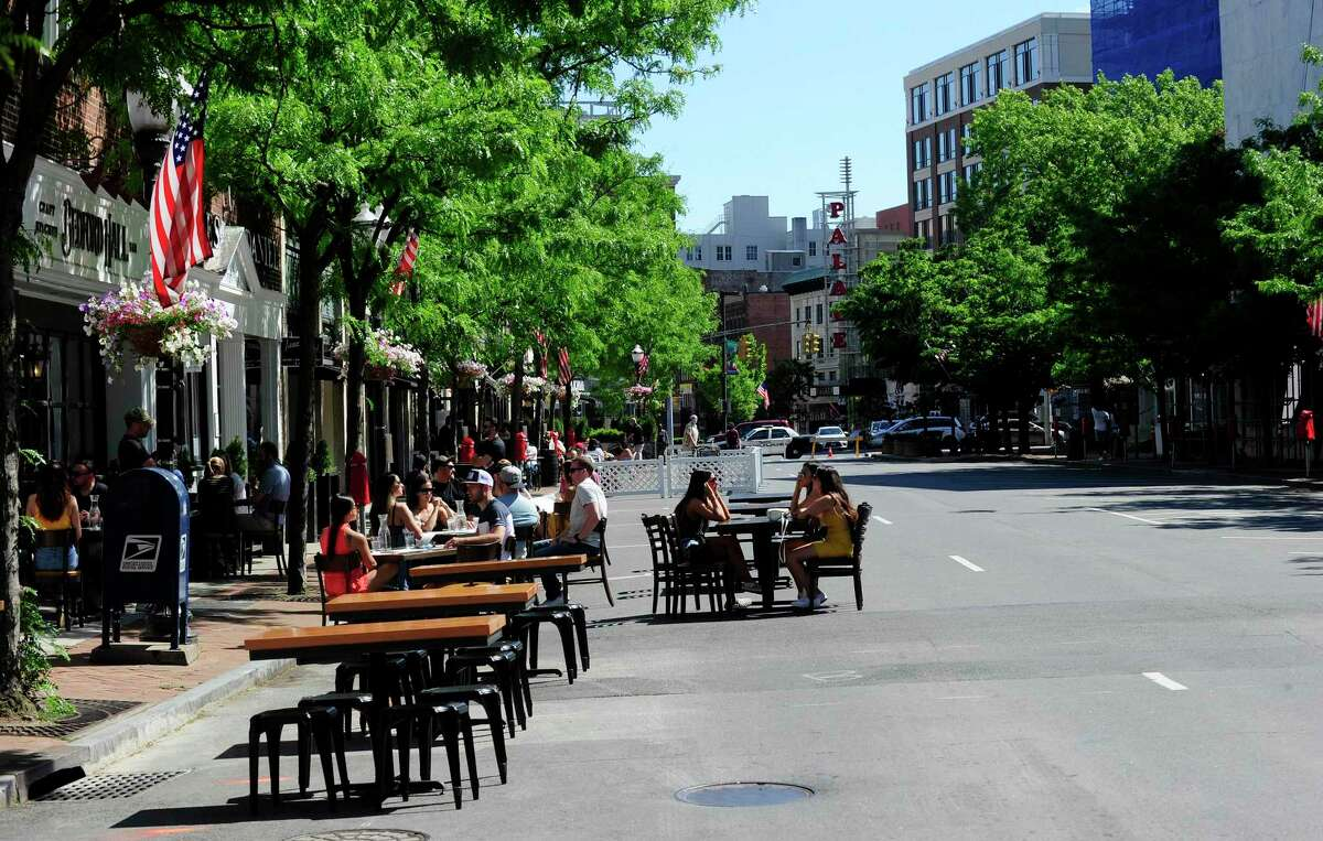 FILE - With Bedford Street closed to traffic, area restaurants extend their outdoor dining into the street, transforming the area into Streateries on May 30, 2020 in Stamford, Connecticut.
