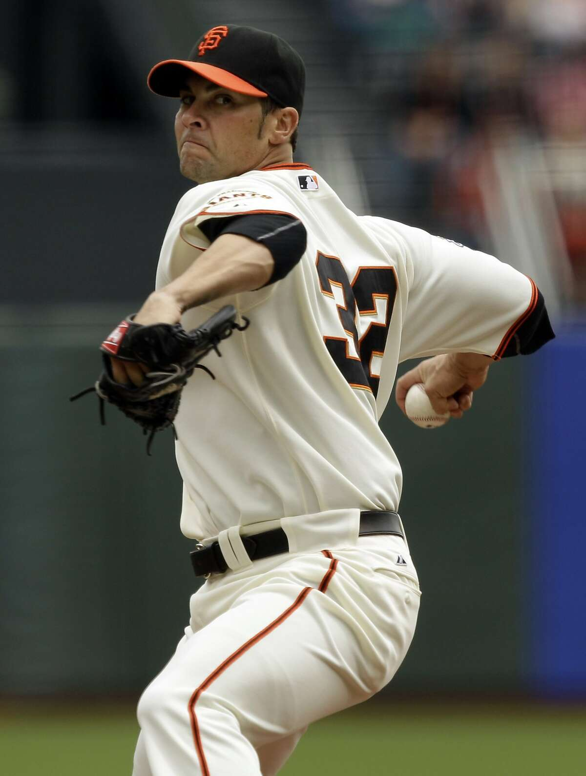 San Francisco Giants pitcher Ryan Vogelsong (32) throws to the Colorado Rockies during the first inning of a baseball game in San Francisco, Sunday, June 5, 2011. ~~