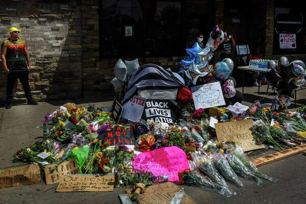 May 26: Minneapolis memorial set up for George Floyd Flowers, signs, and balloons are left near a makeshift memorial to George Floyd near the spot where he died while in the custody of the Minneapolis police. This slideshow was first published on Stacker