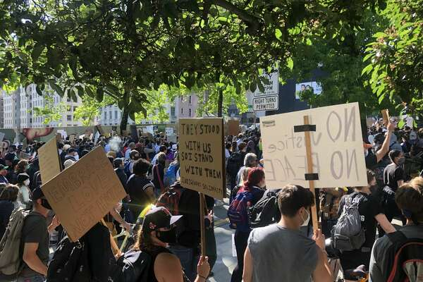 Protesters march against police brutality in downtown Seattle, June 1, 2020.
