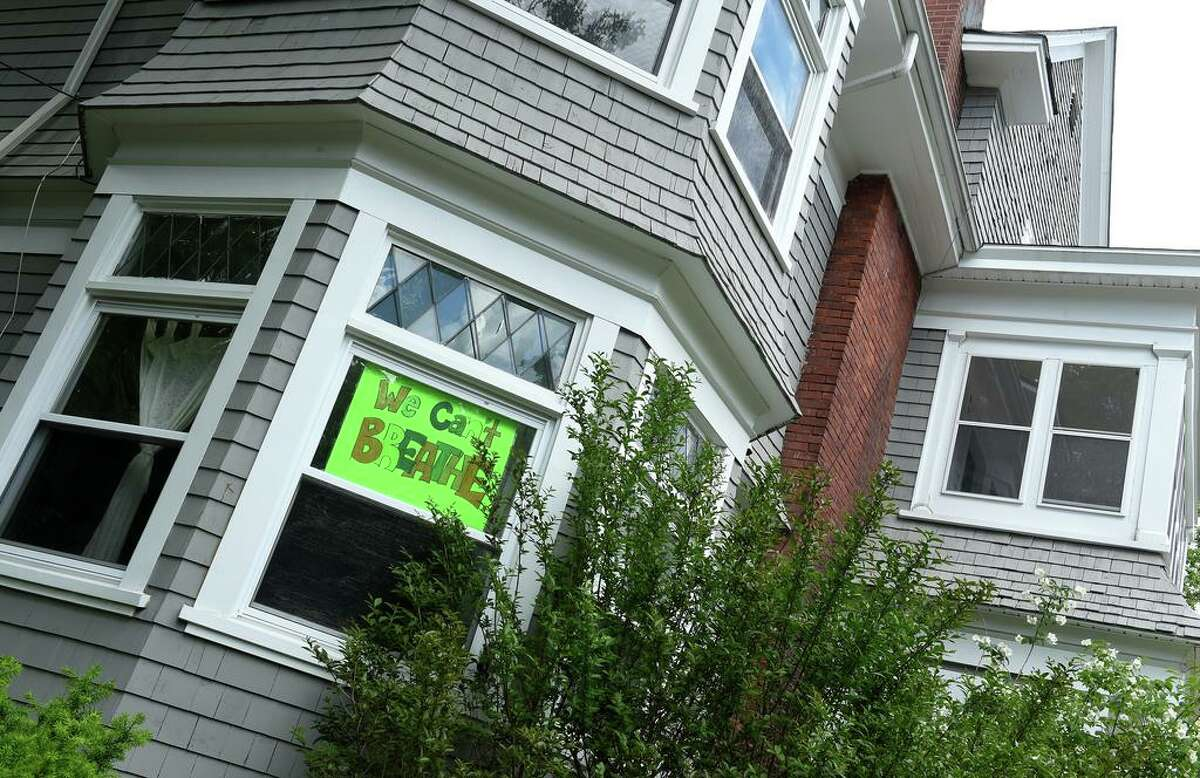 A We Can't BREATHE sign hangs in the window of a home in New Haven on June 1, 2020.