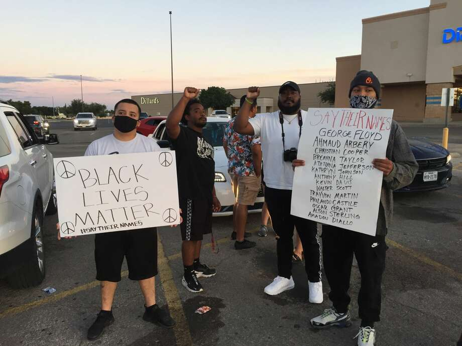 A small group gathered Tuesday evening at the Midland mall to continue to protest. Photo: Tim Fischer/Midland Reporter-Telegram