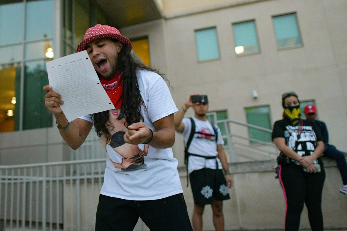 C.J. Vergara reads a list of reforms that he and a group called Young Ambitious Activists ask of police Monday.