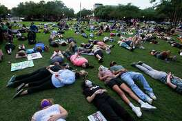 More than 200 people lay down, or kneel down, or lay in arrest position silently for eight minutes and forty-six seconds at Town Center Park to honor George Floyd, who died in Minneapolis Police Department custody a week ago, Monday, June 1, 2020, in Kingwood. The event was organized by two Humble ISD teachers, Cindy Welch and Gaby Diaz.