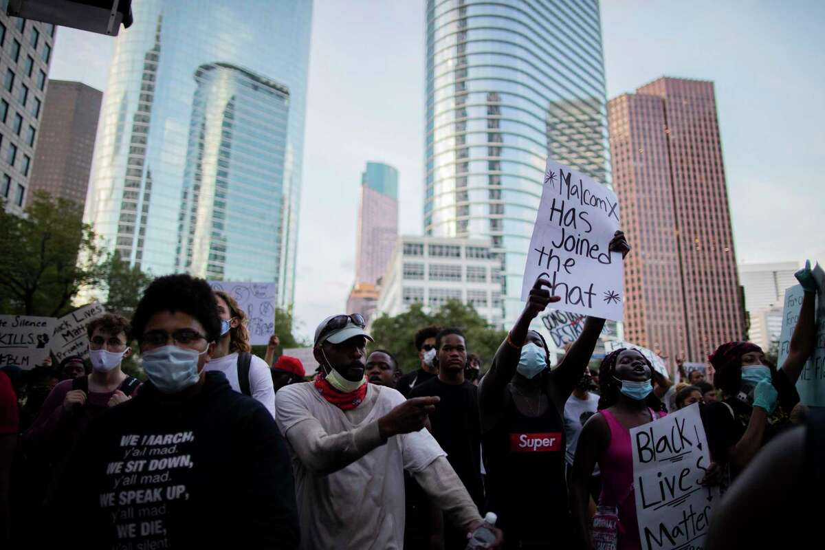 A demonstration against the death of George Floyd in police custody takes place in downtown Houston on Saturday, May 30, 2020.