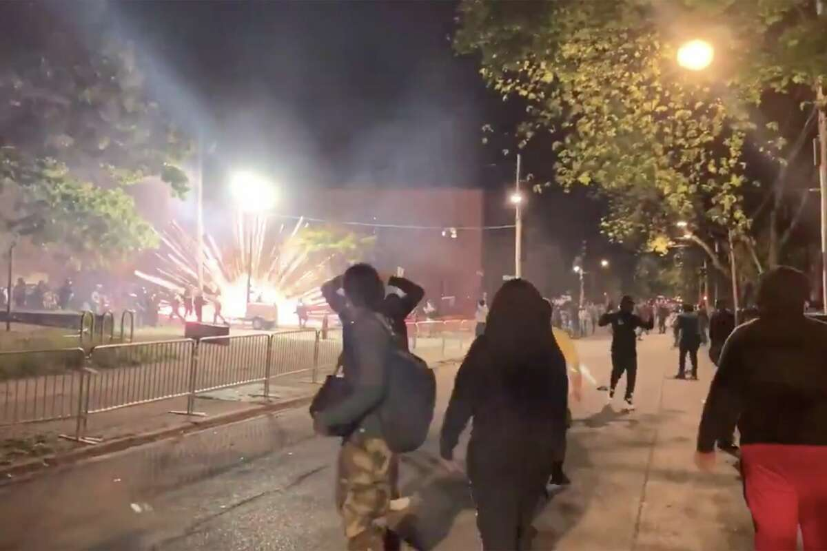 A protest at the city's police headquarters devolved late Monday night, as people shot off loud fireworks and police responded by shooting tear gas toward people who remained around Henry Johnson Boulevard. (Michael Williams/Times Union)