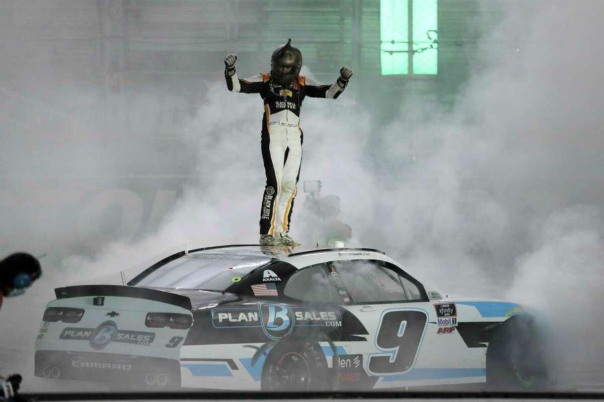 Noah Gragson (9) celebrates after winning a NASCAR Xfinity Series auto race at Bristol Motor Speedway Monday, June 1, 2020, in Bristol, Tenn. (AP Photo/Mark Humphrey)