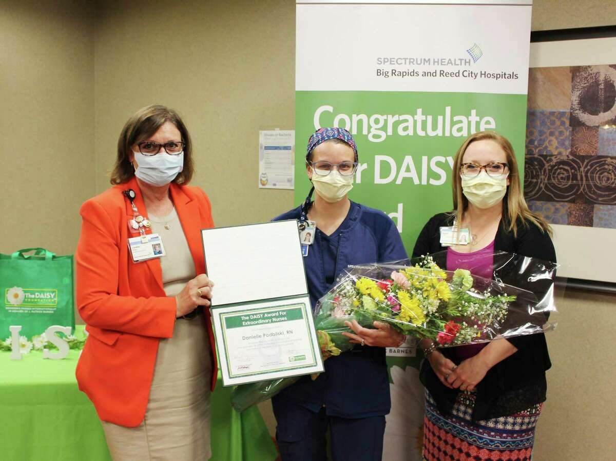 DAISY winner, Danielle Podbilski, RN, is shown at center with chief nursing officer Caroline Ring, left, and Reed City Hospital emergency department nurse manager Jennifer Lokers. (Submitted photo)