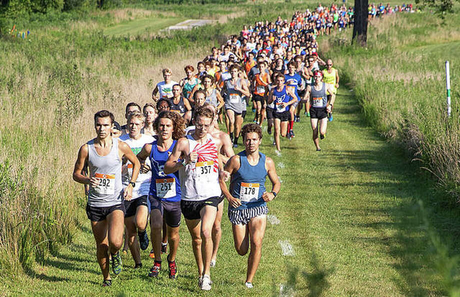 Runners take off from the starting line on July 27, 2019, during the 24th annual Mud Mountain 5K at the SIUE and EHS cross country course. Photo: Mike Baxter|For The Intelligencer