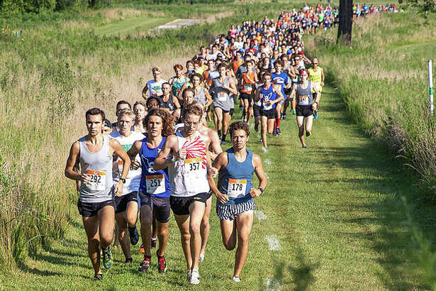 Runners take off from the starting line on July 27, 2019, during the 24th annual Mud Mountain 5K at the SIUE and EHS cross country course.